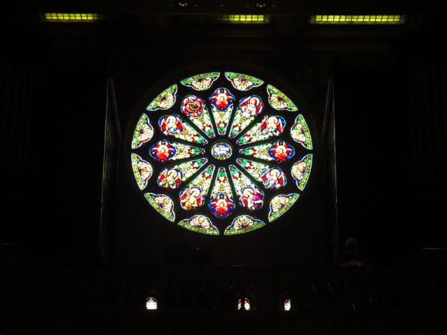 The rose window depicts iconography from the Book of Revelation. San Francisco, United States, North America.