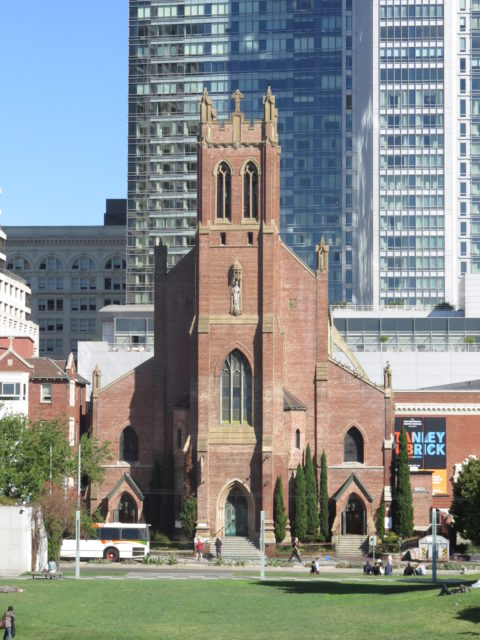 Directly across from Yerba Buena Gardens to the north, the Gothic Revival St. Patrick Church, built in 1914. Unsurprisingly, St. Patrick's originally served an Irish congregation. The congregation is now largely Filipino. San Francisco, United States, North America.