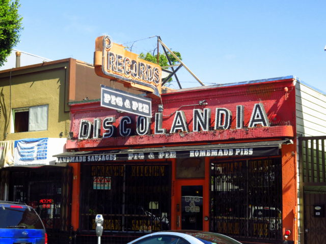 I saw a number of murals that featured a place called Discolandia. So I was very excited to see the actual location on 24th Street. It was an iconic record store serving the Latino community for decades. It's now a restaurant, but community activists convinced the new operators to keep the Discolandia signage. San Francisco, United States, North America.