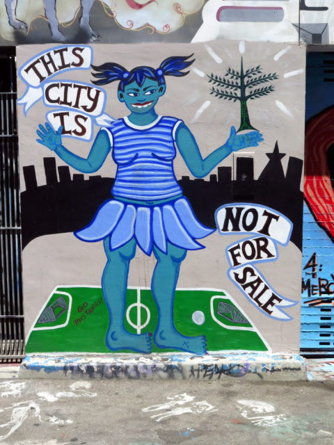 This mural represents a controversy that arose when some of the hated tech workers kicked neighborhood kids off a local soccer field because they had paid to reserve it. Literally pay-to-play. San Francisco, United States, North America.
