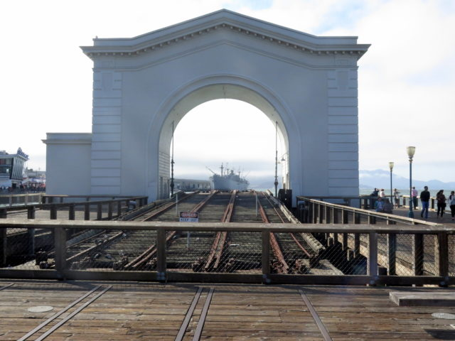 Heading back towards Fisherman's Wharf, these tracks look like they head all the way to the SS Jeremiah O'Brien. But the pier actually ends right past that seaport structure. San Francisco, United States, North America.