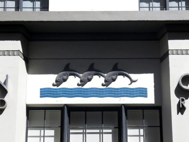 These adorable dolphins welcome you to the Streamline Moderne Rincon Annex. San Francisco, United States, North America.