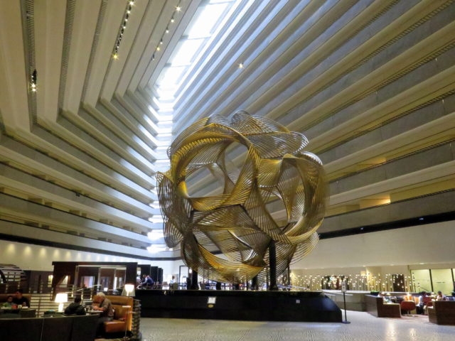 "The atrium of the Hyatt Regency is the world's largest hotel lobby. It was prominently featured in ""The Towering Inferno"" and ""High Anxiety"". The sculpture ""Eclipse"" sits in the center of the lobby. Naturally, it changes color. San Francisco, United States, North America."