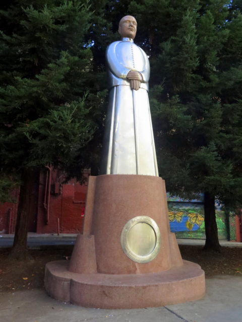 Proudly standing in St. Mary's Square, the 14-foot red granite and stainless steel sculpture of Sun Yat-sen, father of the Chinese Republic, by Beniamino Bufano. San Francisco, United States, North America.