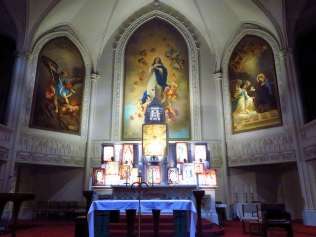 """The beautiful chancel in Old St. Mary's in Chinatown. From left to right above the altar: """"St. Michael The Archangel"""", """"The Assumption"""", and """"The Annunciation"""". San Francisco, United States, North America."""