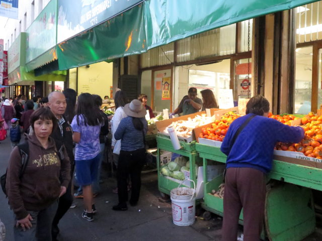 Chinatown locals doing their weekend shopping at the markets that line Stockton Street. San Francisco, United States, North America.