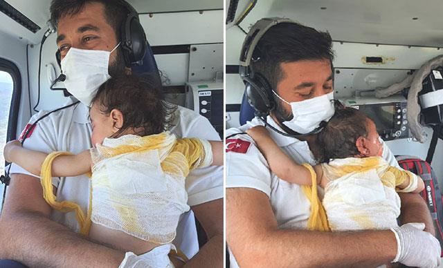 Kaynar suyla yanan Beril bebek ve Acil Tıp Teknisyeni Mehmet Canko'nun fotoğrafı sosyal medyada gündem oldu