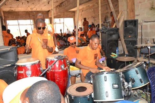Bina musical band praises God with their instruments at the church service