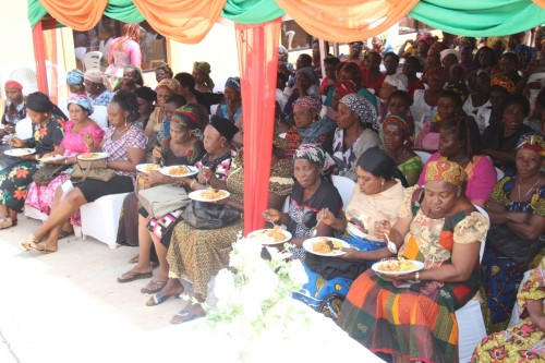 Indigent widows enjoying their meal during the WIDOWS DAY OF JOY