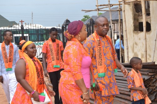 Project Facilitator with her family arrives the Church of Transfiguration for church service