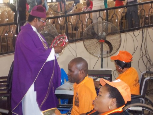 The Most Rev Dr. E O Chukwuma sings with Bina Foundation musical band