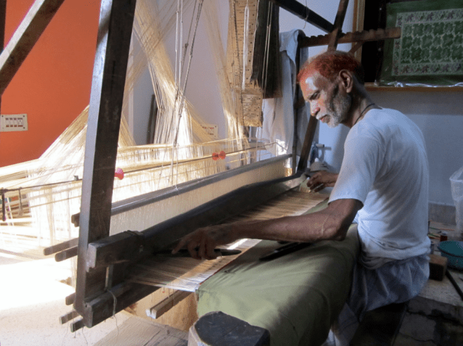 A weaver on a hand loom in Varanasi