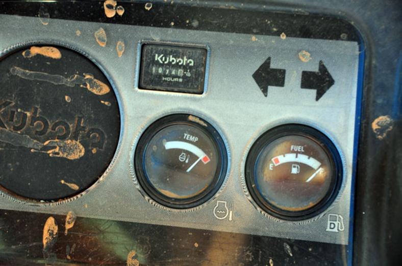 Gauges on dashboard of a Kubota showing it is overheated.