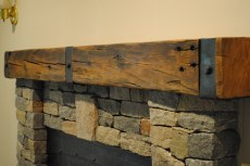 Reclaimed Beam Paired with a Rustic Cast Iron