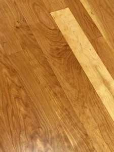 Cherry flooring offers rich red tones and is a traditional flooring choice for formal rooms.