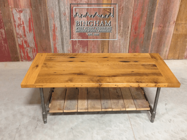 This coffee table is made from reclaimed oak and fashioned with iron pipe legs.