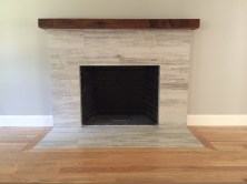 Reclaimed Beam Mantle on a Clean Modern Fireplace