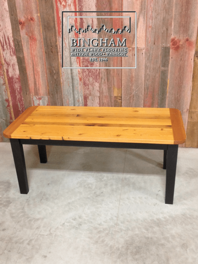 This table top is made from reclaimed heart pine and a poplar base, which is painted black for some contrast to the rich tones in the reclaimed heart pine.