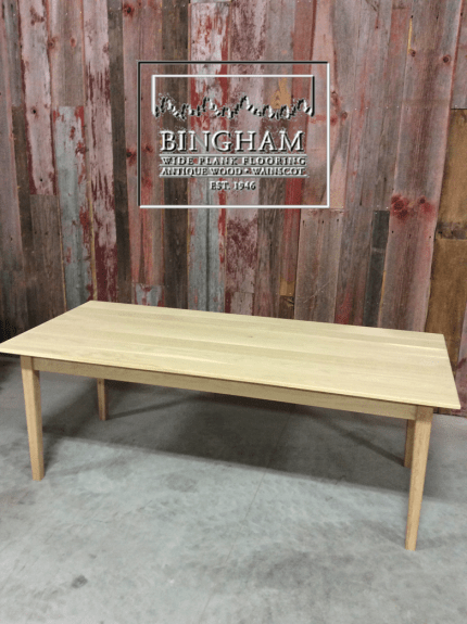 This streamlined oak table is made from classic plank white oak.