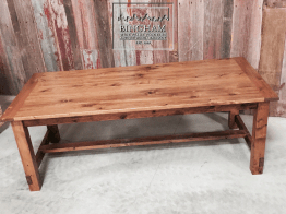 This reclaimed softwood table is finished with a stain and tung oil to give it an older feel yet a smooth finish.