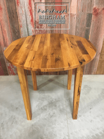 This bar height table is made from reclaimed oak finished with a tung oil finish.