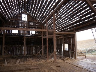 Reclaimed wood comes from all parts of old buildings. Everything from the floors, wall paneling, beams an joist stock can be used to make finished furniture, flooring and much much more.