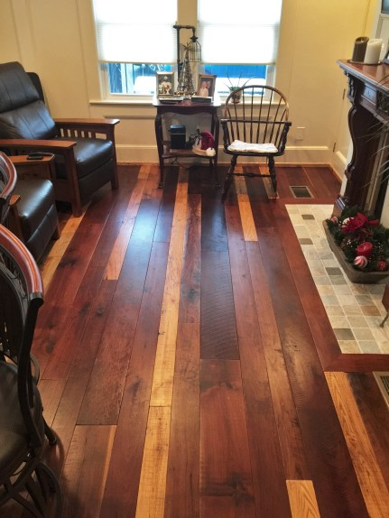 A mixed specie wide plank reclaimed hardwood flooring