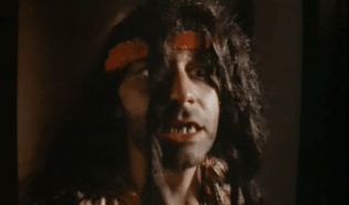 Crazed hippie in a bad wig: Sam Raimi stars.