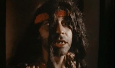 Crazed hippie in a bad wig: Sam Raimi stars.