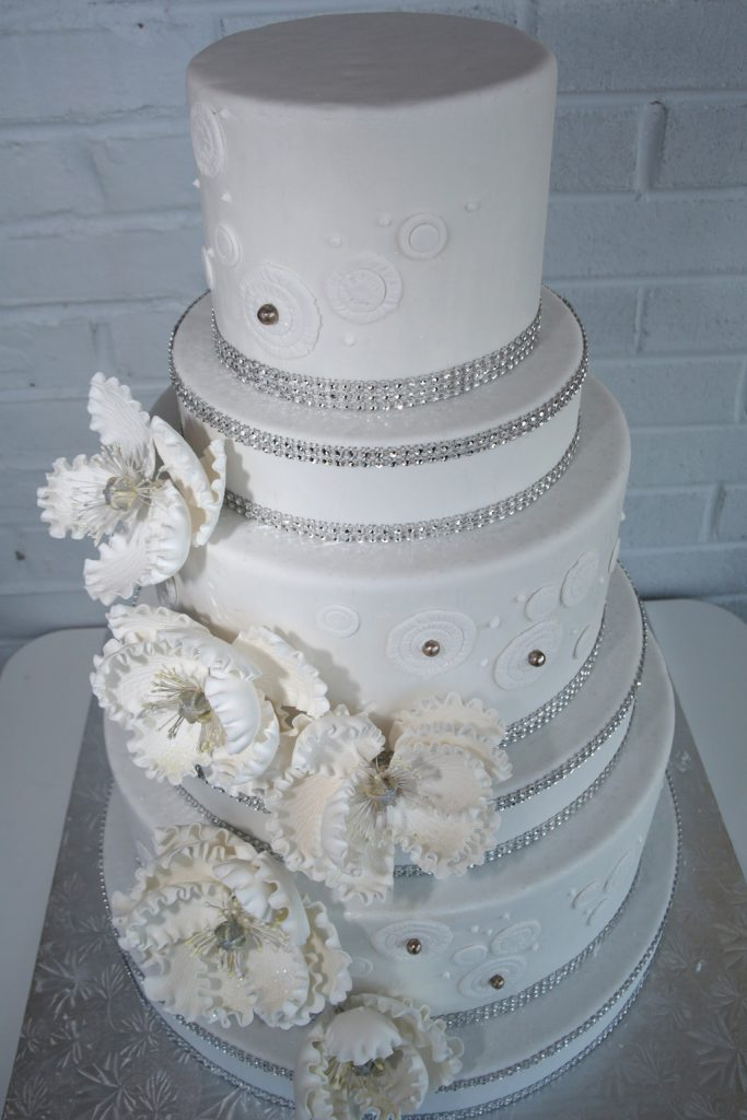 Wedding Cakes   Bing s Bakery     Wedding cake prices start at  3 50 for round cakes and includes one filling  per tier and a standard decoration  Prices will vary depending on cake  choice