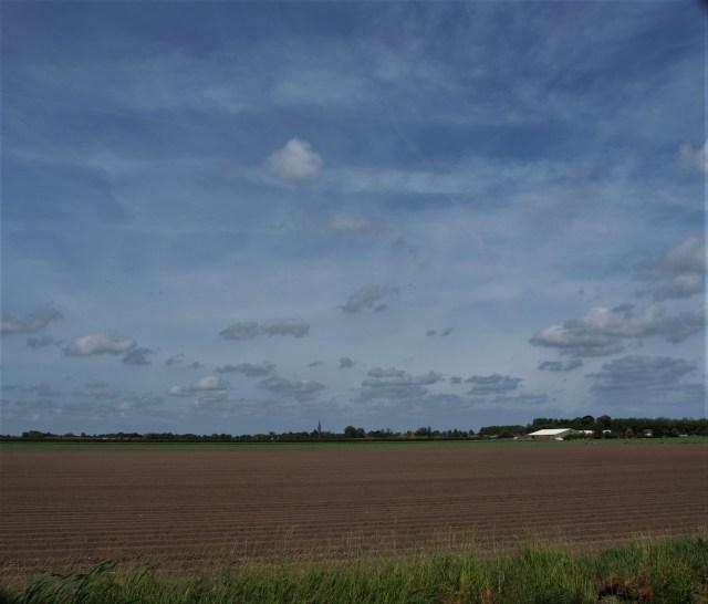 Beemster in Beeld - Omgeploegd land richting Middenbeemster vanaf de Volgerweg