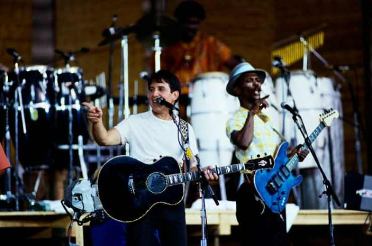 """Paul Simon performs on stage during a tour to promote his """"Graceland"""" album, February 1987"""