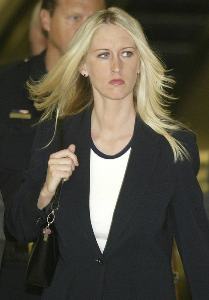 Amber Frey leaves the San Mateo County Courthouse after her second day of testimony in the Scott Peterson double murder trial on August 11, 2004 in San Mateo, California
