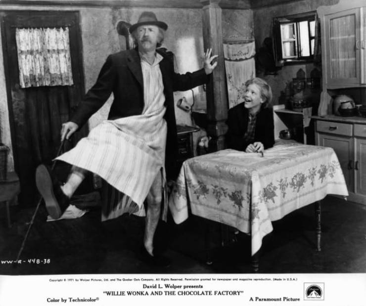 """Jack Albertson dancing in front of Peter Ostrum in a scene from """"Willy Wonka & the Chocolate Factory"""""""
