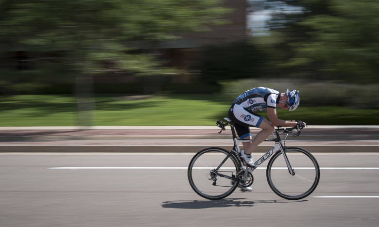 Cyclist with poor  back posture