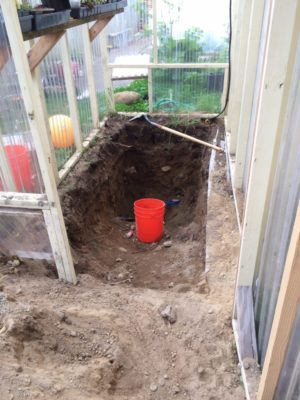 Digging a thermal collector pit.