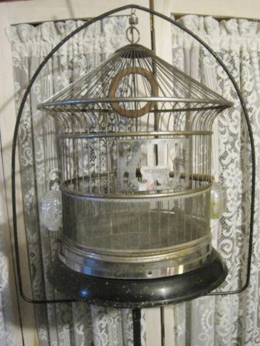 Hendryx, round, hanging pagoda-style bird cage with a brass-wire seed screen and side-out tray.