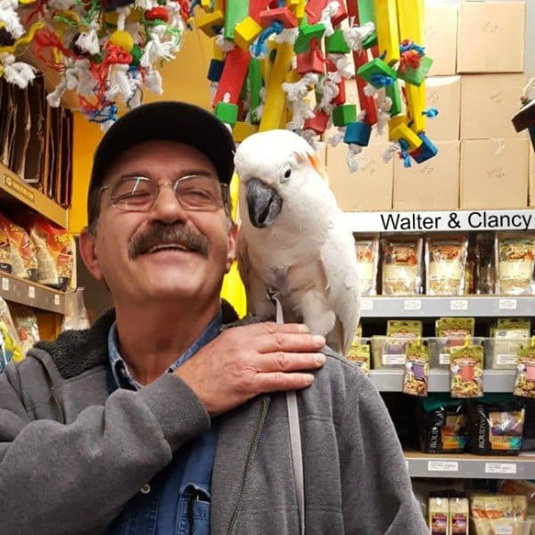 man with cockatoo on shoulder