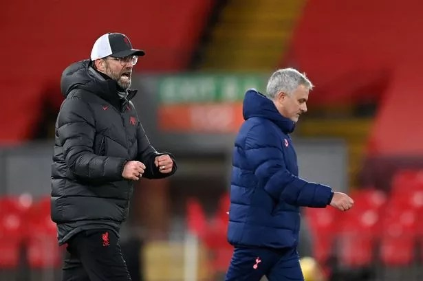 Jurgen Klopp celebrates after sealing a victory over Jose Mourinho and his Tottenham side in the English Premier League