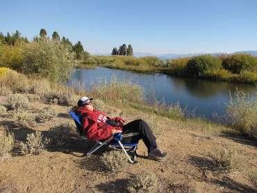 Lynn resting in chair by river