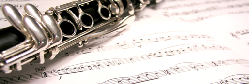 An image of a clarinet on some sheet music