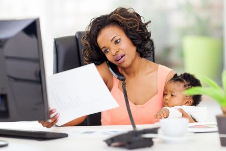 going back to work after baby-woman at work with baby