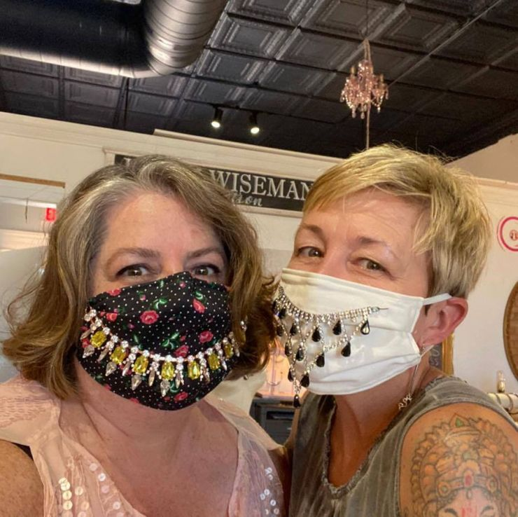 Karin Wiseman (left) and Trayc Claybrook (right) run their respective shops in addition to an art center, the Art Lounge, in the same shop building in downtown Garland.