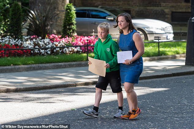 Thomas Braun, left, Ilmarie Braun, right, and her family pay £ 780 a month to allow Eddie Braun to receive treatment at the NHS