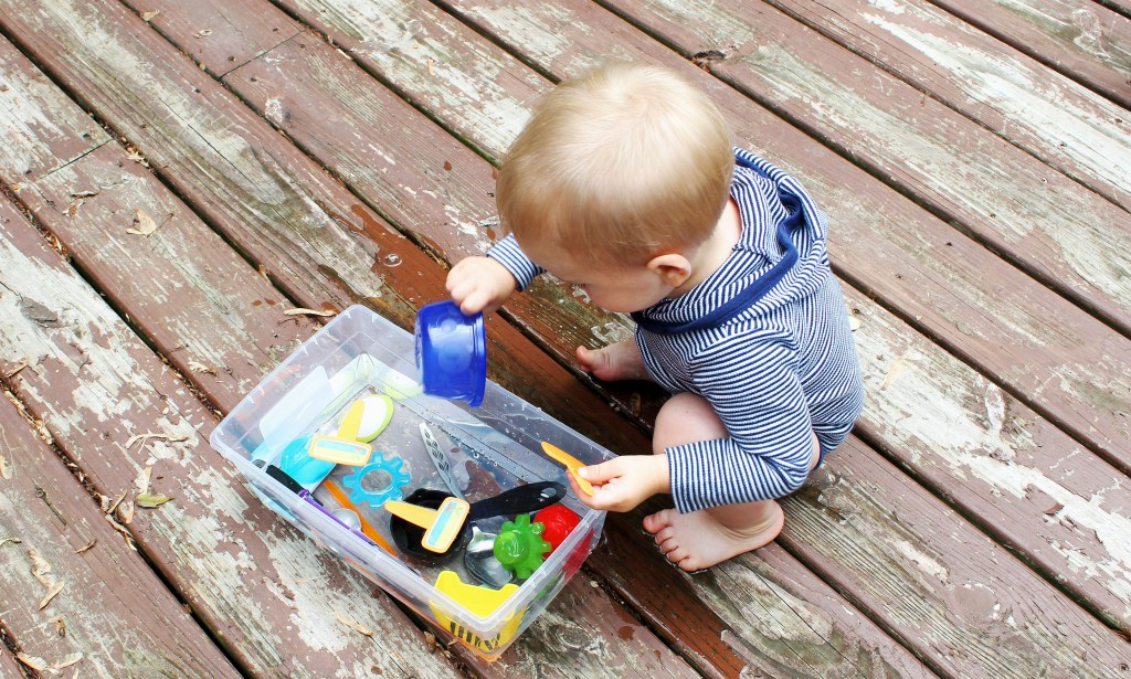 baby playing with sensory bin