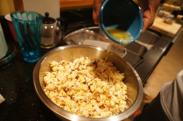 butter poured on popcorn