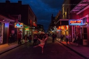 """It was our last night in NOLA, and we took the """"scenic"""" route back to our hotel. With the New Orleans Jazz playing all around us, The Girl couldn't help but dancer in the middle of Burbon Street. I couldn't capture her as well as I'd hoped, but I love this photo nonetheless."""