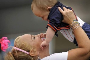 Registered nurse Lynn Ellsworth of North Grafton plays with her former patient, Luke Goyette, 11 months, of Millbury during the UMass Memorial Neonatal Intensive Care Unit's 40th anniversary celebration Saturday. (T&G Staff/PAUL KAPTEYN)