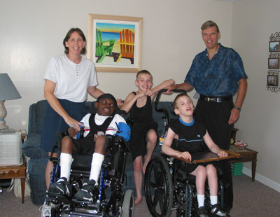 The Bissell family, from left: Cindy, Anthony (in wheelchair), Aaron (standing), Eric (in wheelchair), and Richard, who became a nurse in 1990, soon after his father died. He began his career working in geriatrics providing care for individuals with end-stage Alzheimer disease. In 1993, after the pre- mature birth of his twin sons, both of whom have developmental disabilities, Bissell became an advocate for people with mental retardation. In 2001 he received the Massachusetts Governor's Citation for extraordinary and exemplary efforts of behalf of people with mental retardation.