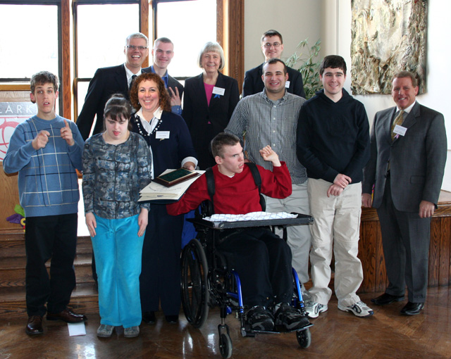 Front Row (left to right): Jonathan Carlson, Marika Jelovcich, Linda Barry, Eric Bissell, Brendan Griffin, Taylor Dee, and Representative John P. Fresolo Back Row (left to right): Richard Bissell, Aaron Bissell, DDS Commissioner Elin M. Howe, and Jason Palitsch representing Senator Mike Moore